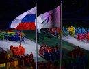 Артисты выступают во время театрализованного представления на церемонии закрытия XI зимних Паралимпийских игр в Сочи