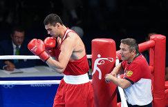 Евгений Тищенко (Россия) и тренер Олег Меньшиков