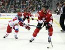 Форвард сборной России Никита Кучеров (слева) и нападающий сборной Канады Джонатан Тэйвз