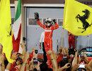 Пилот Феррари Себастьян Феттель после победы на Гран-при Бахрейна