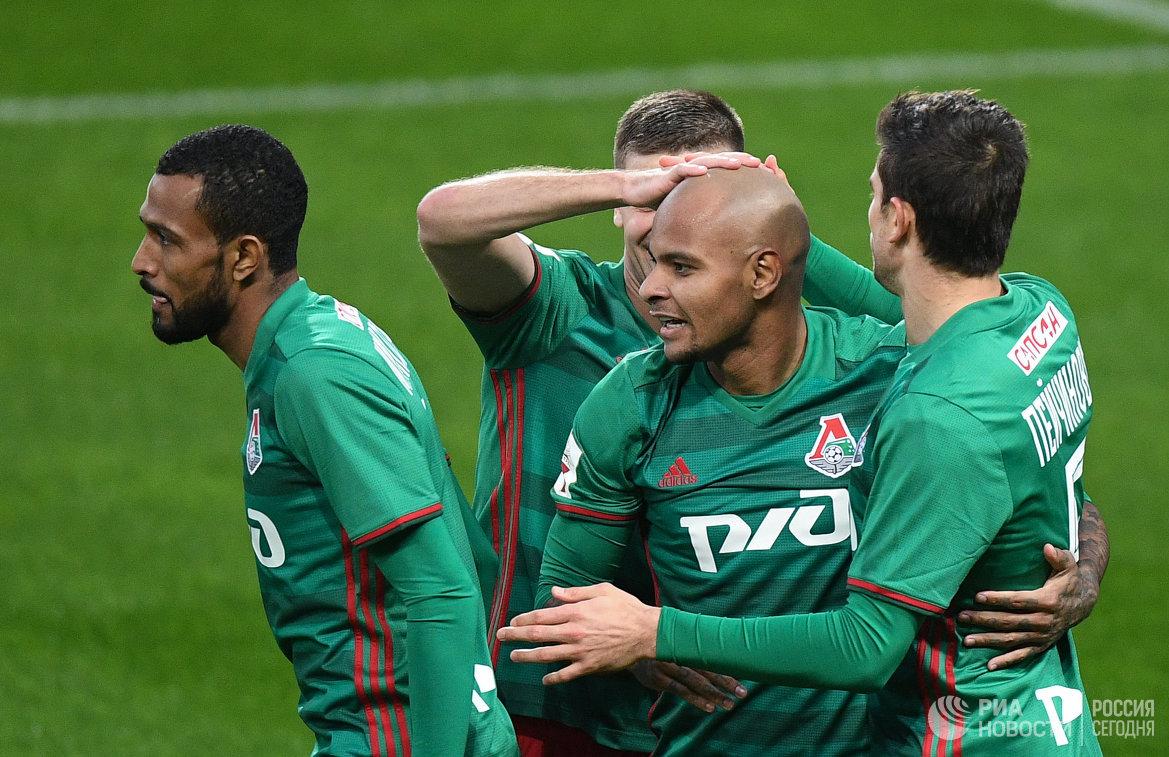 Футболисты Локомотива Майкон, Ари, Алексей Миранчук и Неманья Пейчинович (слева направо)
