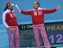 Cтарший тренер мужской сборной России по керлингу Василий Гудин (слева) и тренер команды Роджер Шмидт