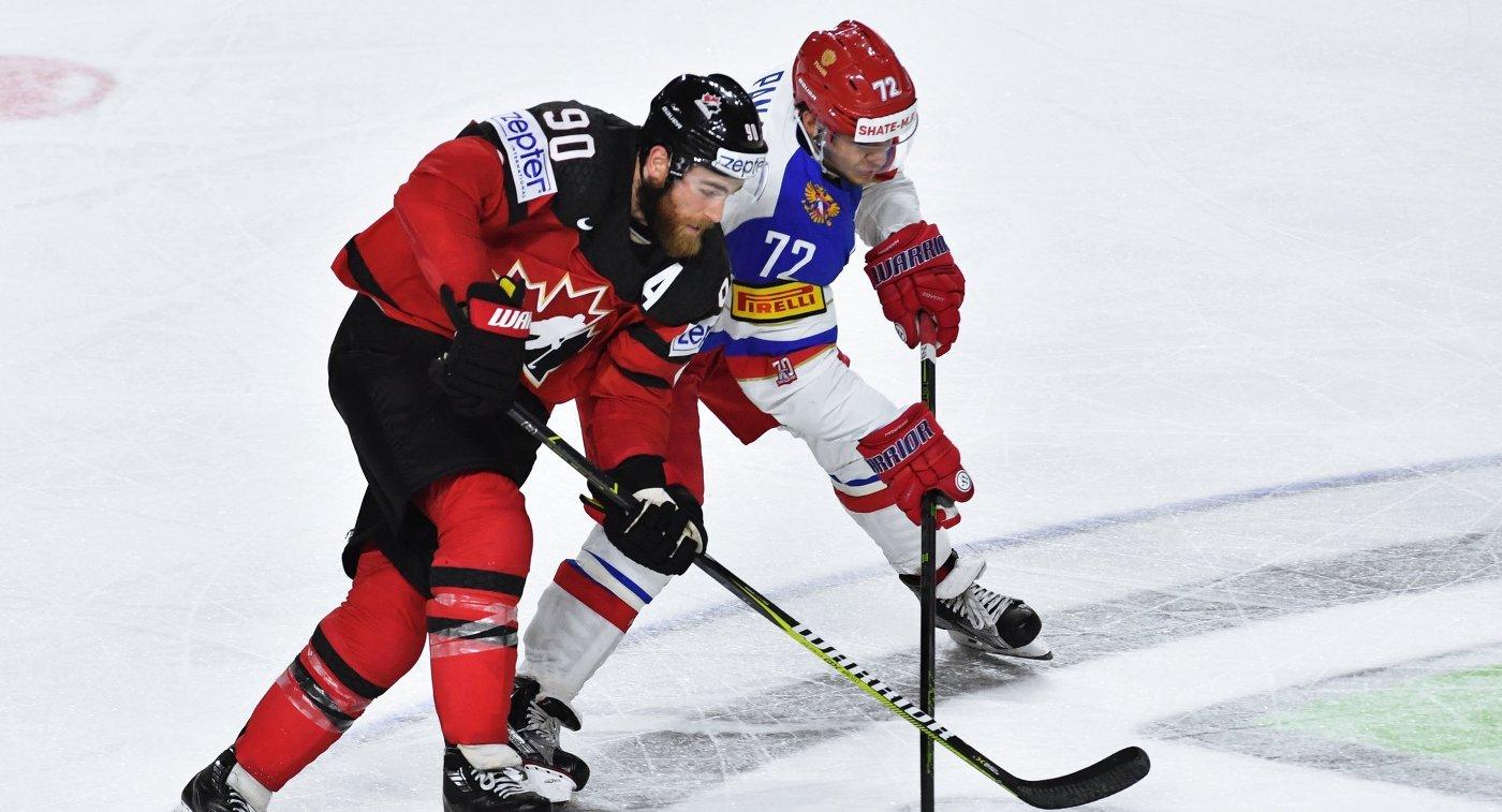 Форвард сборной Канады Райан О'Райлли (слева) и нападающий сборной России Артемий Панарин
