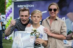 Один из героев турнира МегаФона среди детских домов и школ-интернатов Будущее зависит от тебя, признанный лучшим игроком Владислав Зубачев (в центре)
