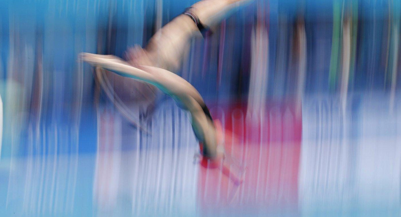 Российские прыгуны в воду Юлия Тимошинина и Виктор Минибаев