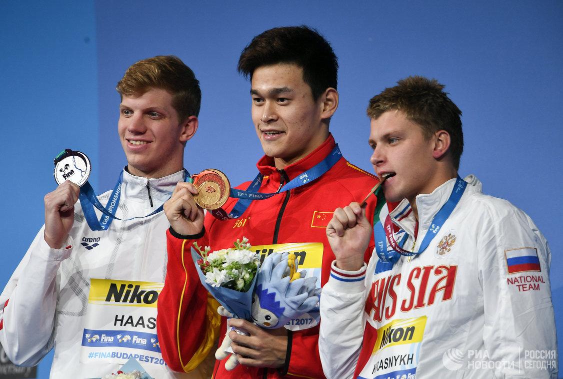 Таунли Хаас, Сунь Ян и Александр Красных (слева направо)