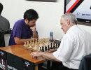 Гарри Каспаров (справа) и Хикару Накамура