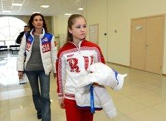 Юлия Липницкая (на первом плане) с тренером Этери Тутберидзе