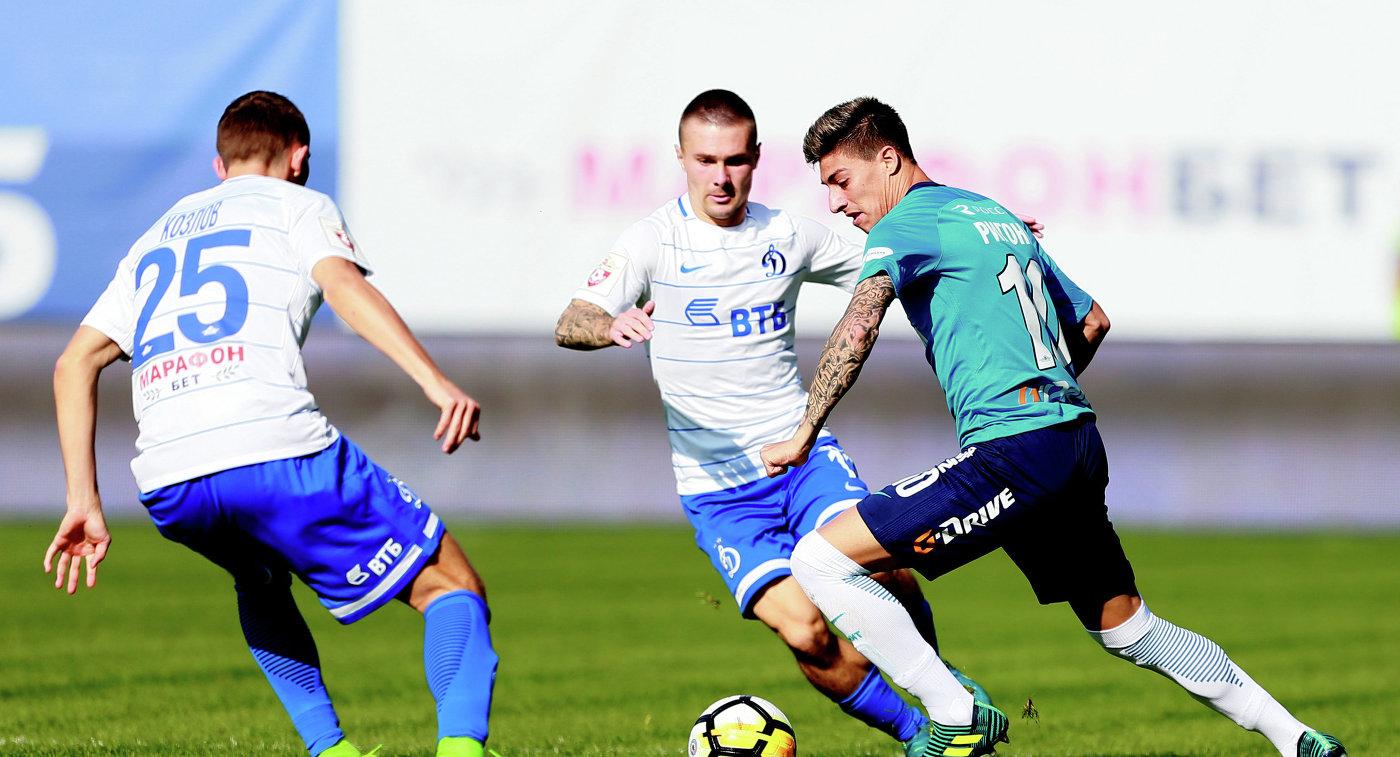 Защитники Динамо Алексей Козлов, Иван Темников и полузащитник Зенита Эмилиано Ригони (слева направо)