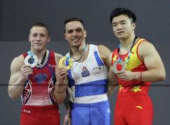 Россиянин Денис Аблязин, грек Элефтериос Петруниас и китаец Лю Ян (слева направо)