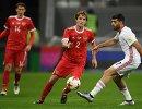 Защитники сборной России Илья Кутепов, Марио Фернандес и форвард сборной Ирана Мехди Тареми (слева направо)