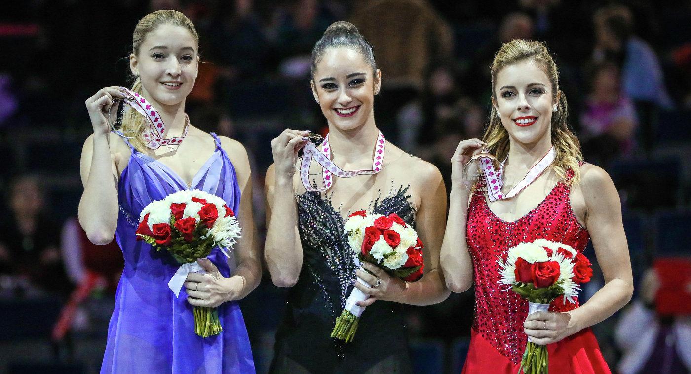 Россиянка Мария Сотскова (слева), канадка Кейтлин Осмонд (в центре) и американка Эшли Вагнер