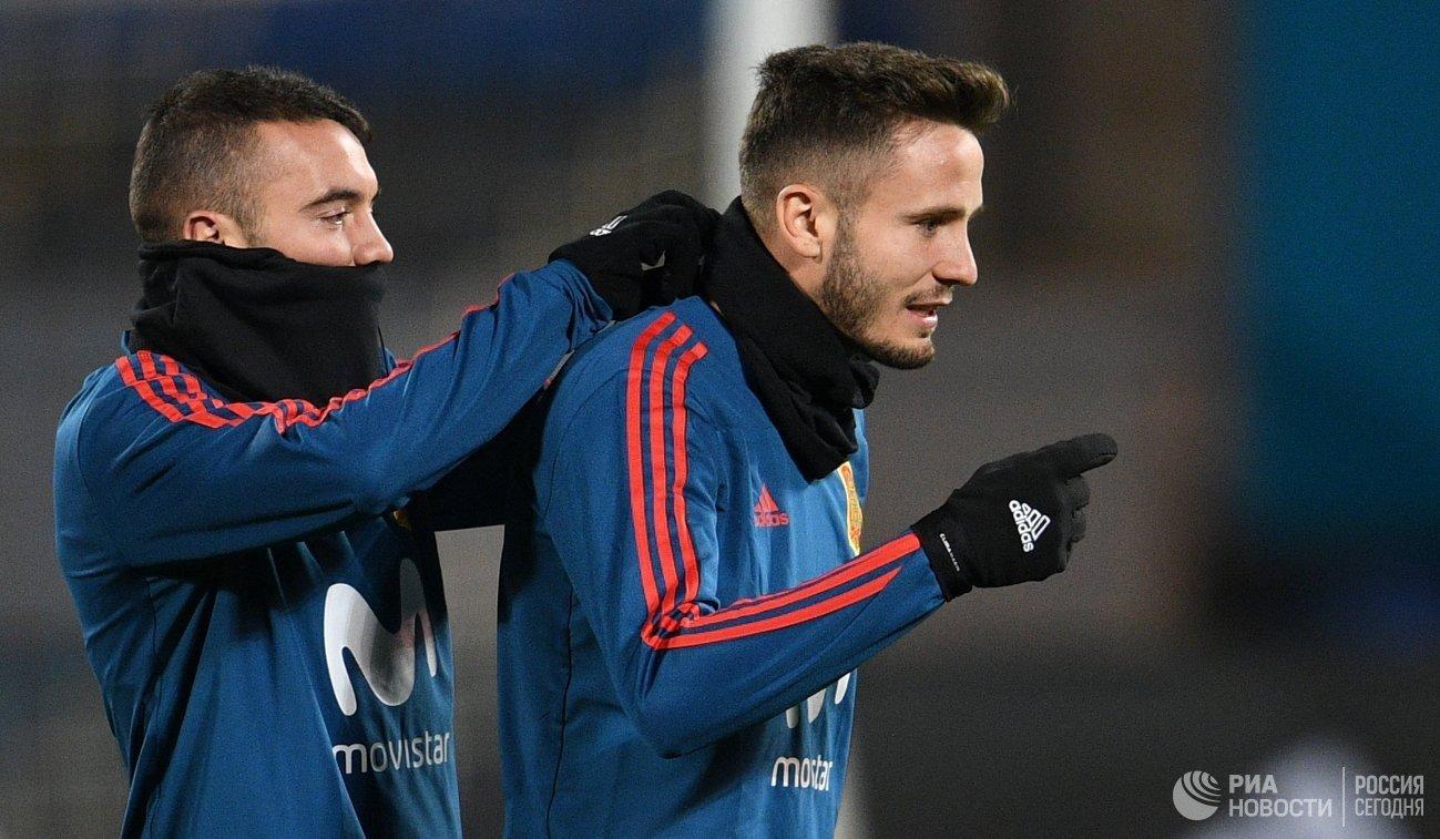 Футболисты сборной Испании по футболу Яго Аспас (слева) и Сауль