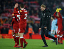 Главный тренер Ливерпуля Юрген Клопп (справа) радуется победе