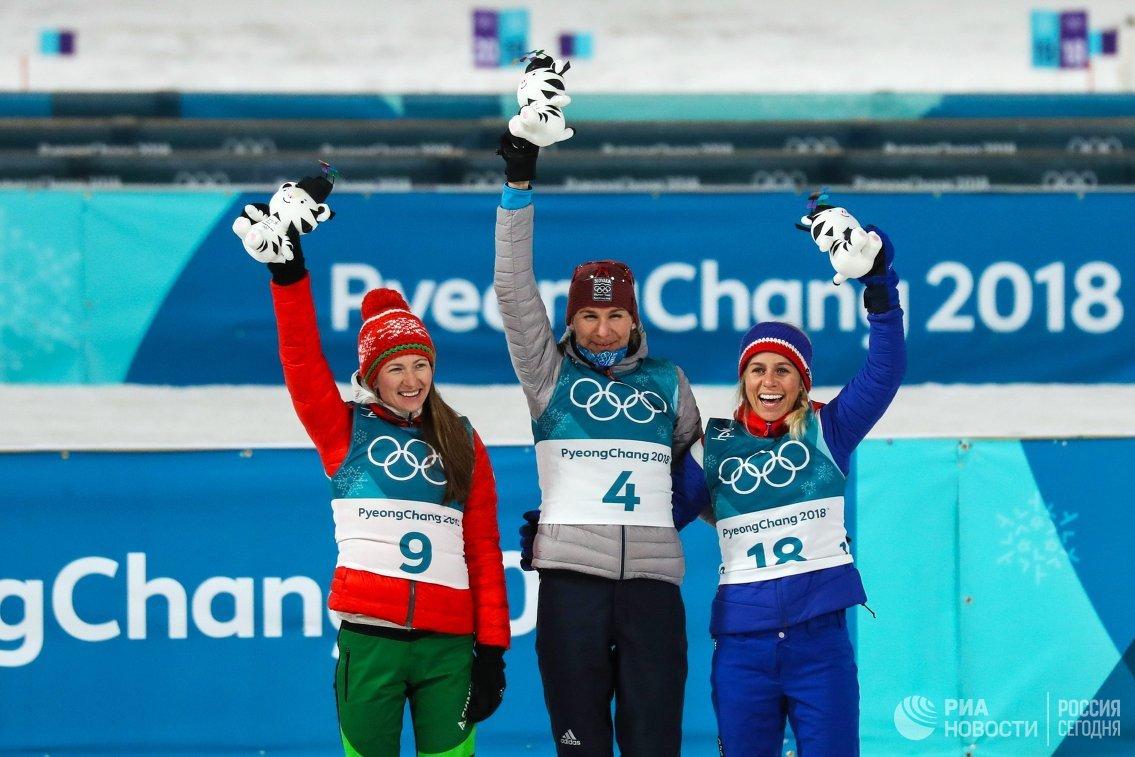 Дарья Домрачева, Анастасия Кузьмина и Тириль Экхофф (слева направо)