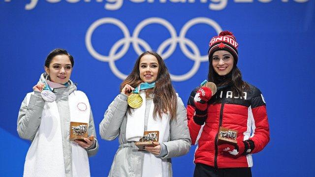 Евгения Медведева, Алина Загитова, Кэйтлин Осмонд (слева направо)