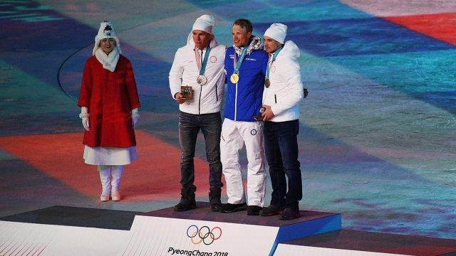 Александр Большунов, Йиво Нисканен и Андрей Ларьков (слева направо)