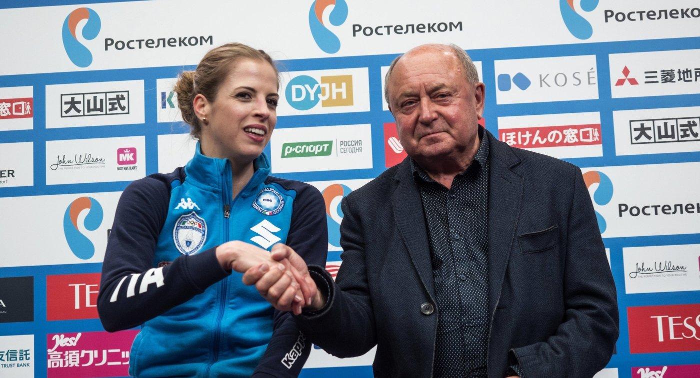 Каролина Костнер и тренер Алексей Мишин (справа)
