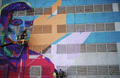 Граффити на стене здания в Казани с изображением игрока сборной России по футболу Руслана Камболова
