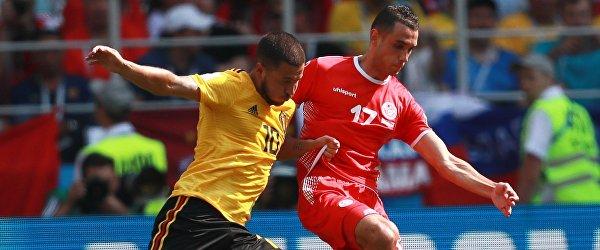 Капитан сборной Бельгии Эден Азар и полузащитник сборной Туниса Эльес Шкири (Слева направо)
