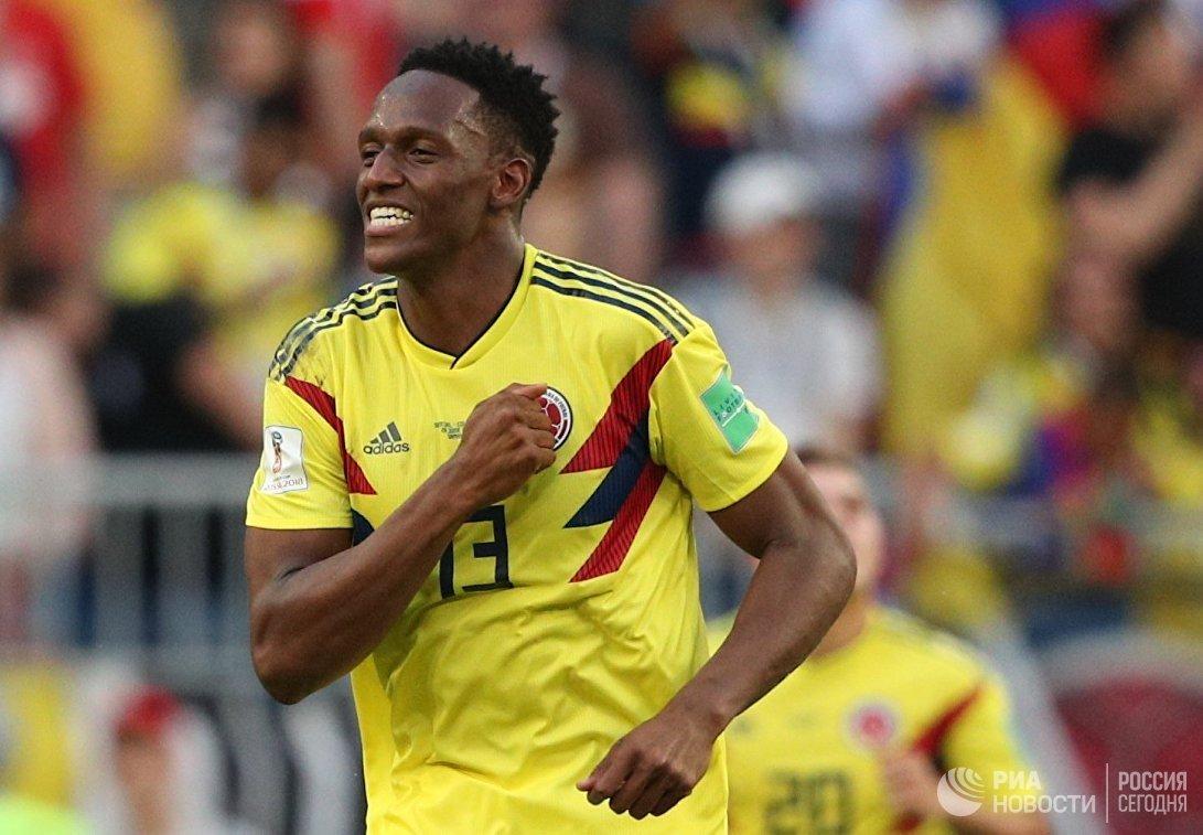 Защитник сборной Колумбии Йерри Мина радуется забитому мячу