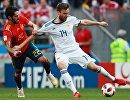 Испанский полузащитник Иско и защитник сборной России Владимир Гранат