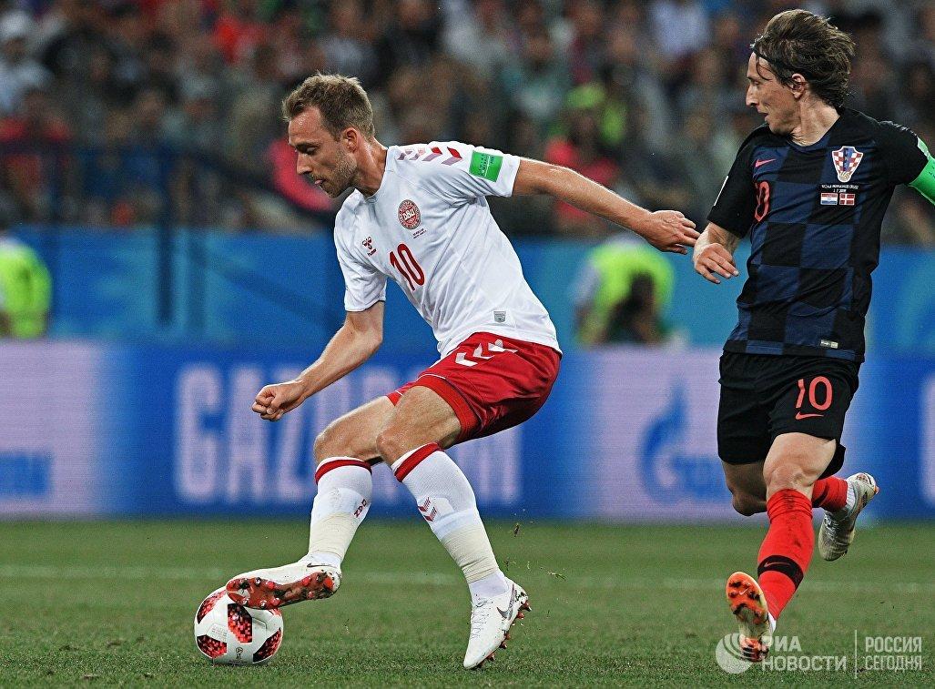 Датский полузащитник Кристиан Эриксен и хорватский футболист Лука Модрич (Слева направо)