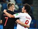 Хорватский футболист Иван Ракитич и датский полузащитник Томас Дилейни (Слева направо)