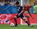 Японский полузащитник Синдзи Кагава и защитник сборной Бельгии Венсан Компани (Слева направо)