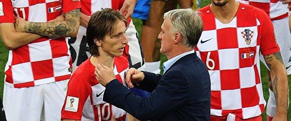 Капитан сборной Хорватии Лука Модрич и главный тренер сборной Франции Дидье Дешам