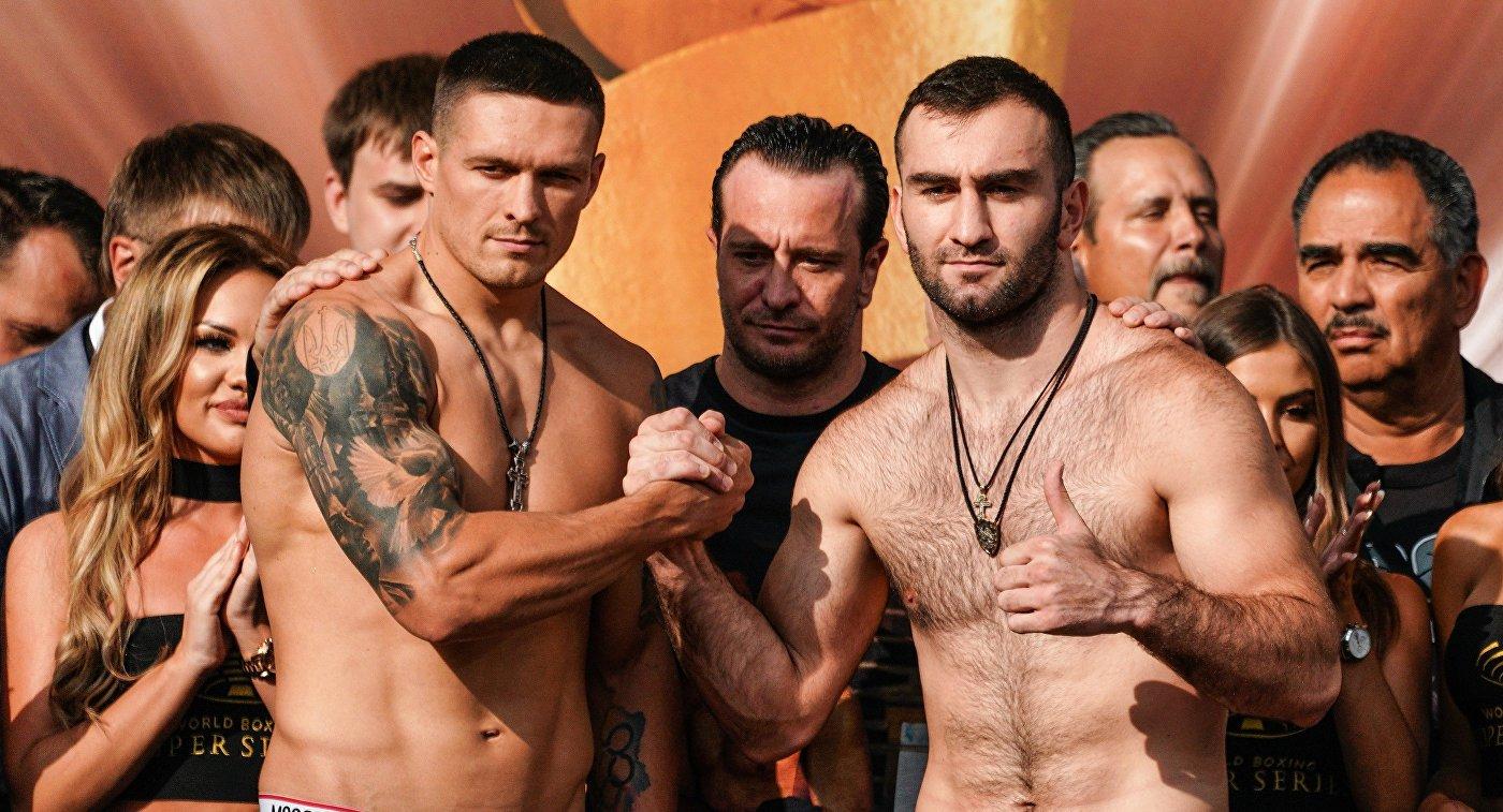 Слева направо: Александр Усик (Украина) и Мурат Гассиев (Россия)