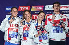 Сборная России по плаванию Владимир Морозов, Юлия Ефимова, Светлана Чимрова и Климент Колесников (слева направо)