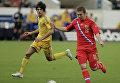 Игровой момент матча Россия - Украина