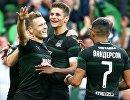 Футболисты Краснодара Виктор Классон, Александр Мартынович и Вандерсон радуются забитому голу