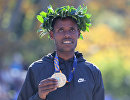 Эфиопский бегун Лелиса Десиса