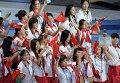 Делегация сборной Китая во время парада спортсменов на церемонии открытия XXVII Всемирной летней Универсиады 2013 на стадионе Казань Арена в Казани.