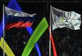 Подъем флага FISU на церемонии открытия XXVII Всемирной летней Универсиады 2013 на стадионе Казань Арена в Казани.