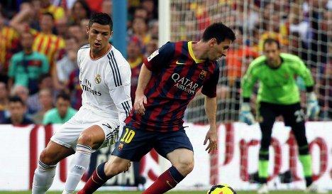 Нападающий Реала Криштиану Роналду и нападающий Барселоны Лионель Месси (слева направо)