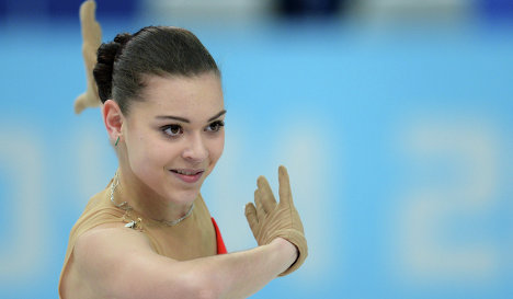 Аделина Сотникова (Россия) выступает в короткой программе женского одиночного катания на зимних Олимпийских играх в Сочи