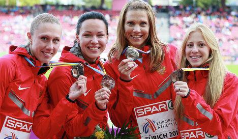 Российская сборная в составе Марины Пантелеевой, Натальи Русаковой, Кристины Сивковой и Елизаветы Савлинис (слева направо)