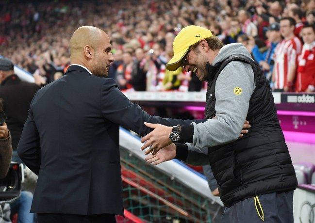 Главный тренер Баварии Хосеп Гваардиола (слева) и главный тренер Боруссии Юрген Клопп