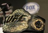 Чемпионский пояс и логотип Абсолютного бойцовского чемпионата (UFC)
