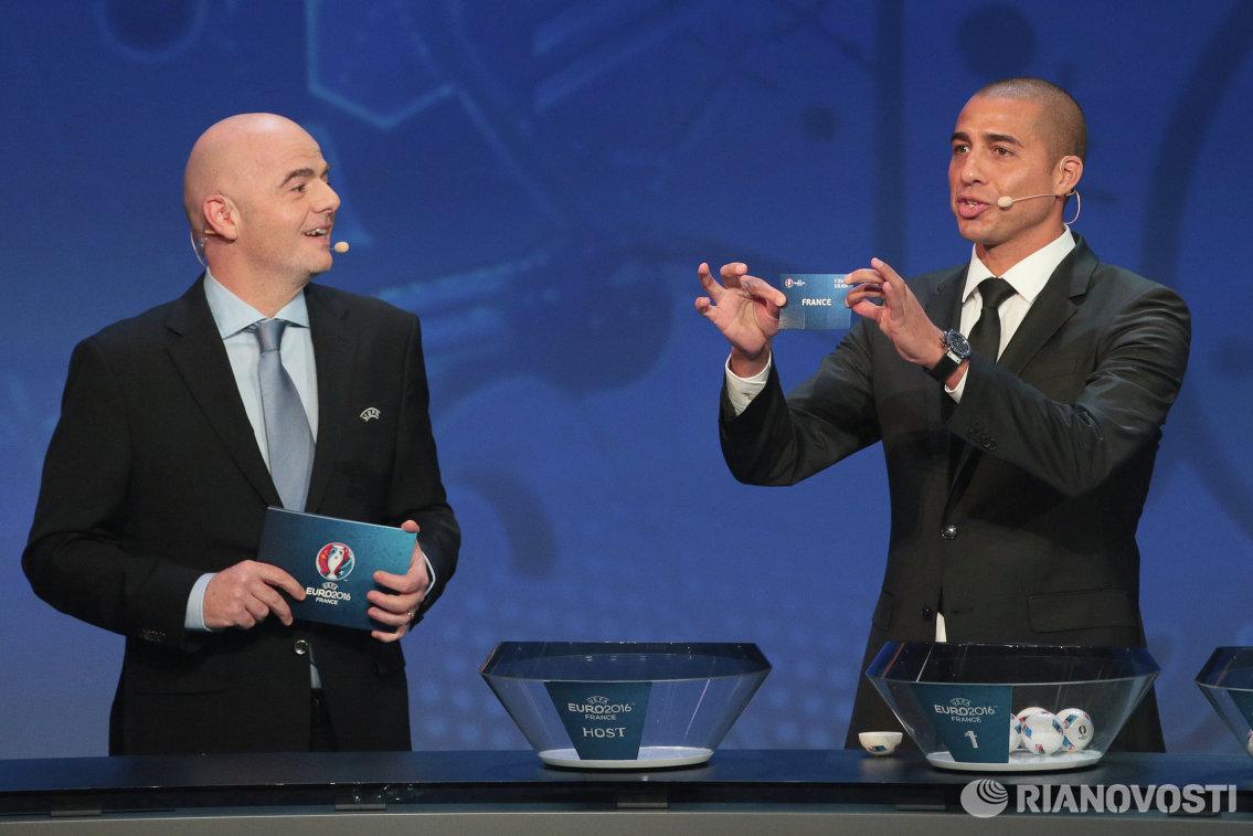 Генеральный секретарь УЕФА Джанни Инфантино и чемпион Европы 2000 года в составе сборной Франции Давид Трезеге (слева направо)