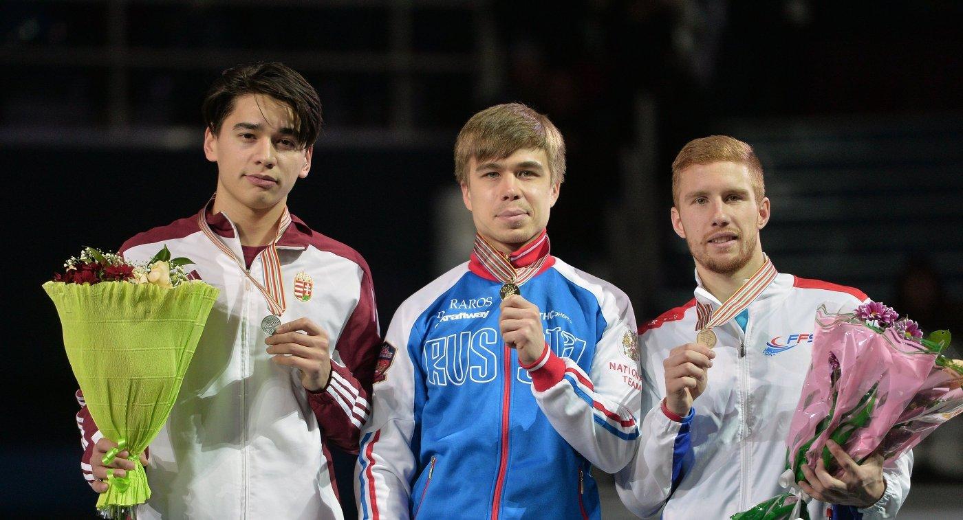 Шандор Лю Шаолинь - серебряная медаль, Семен Елистратов - золотая медаль, Венсан Жанн - бронзовая медаль (слева направо)