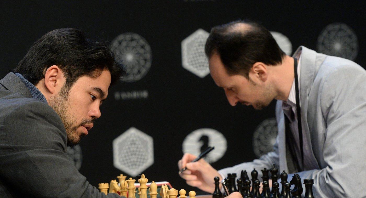 Слева направо: гроссмейстеры Хикару Накамура и Веселин Топалов